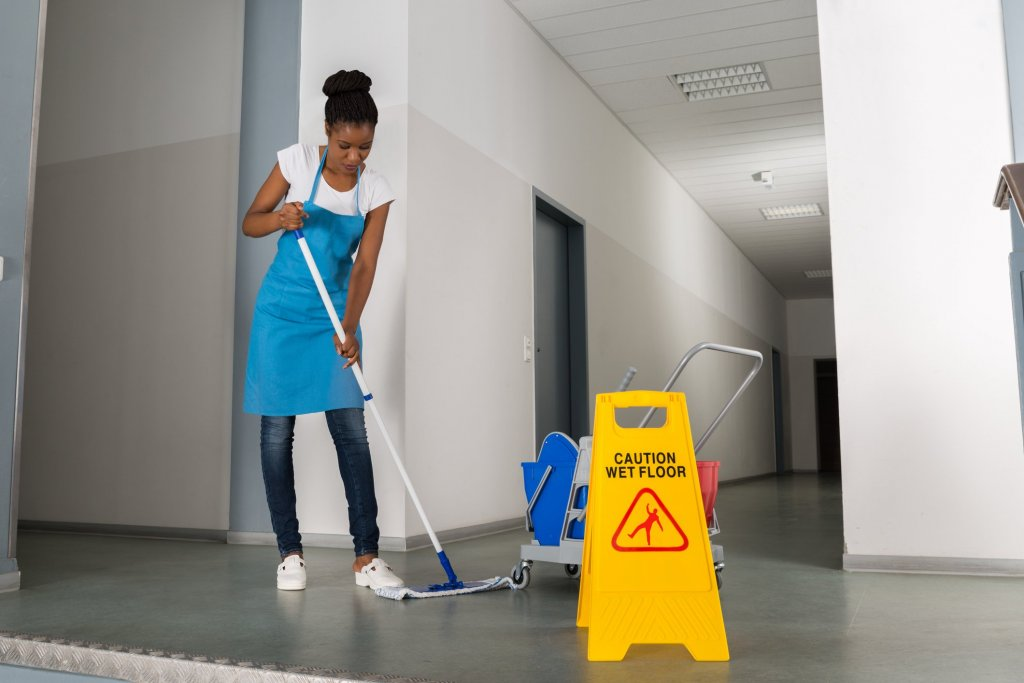 professional cleaner mopping office common areas