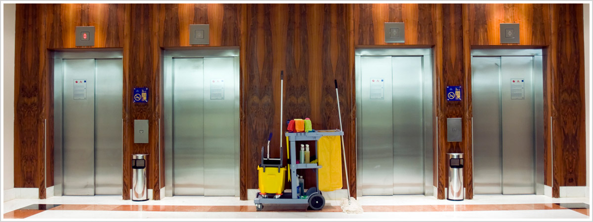 organized janitorial equipment between exceptionally clean elevators