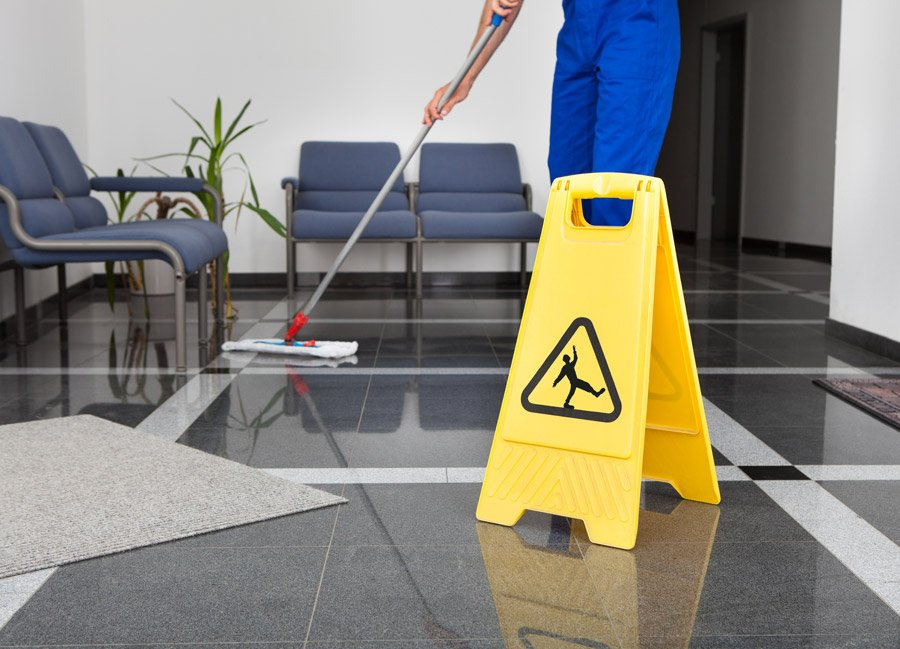cleaning company mopping shiny floors