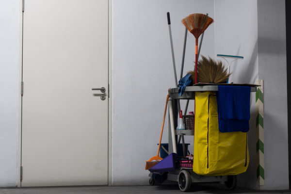 well-kept cleaning equipment in a spotless hallway