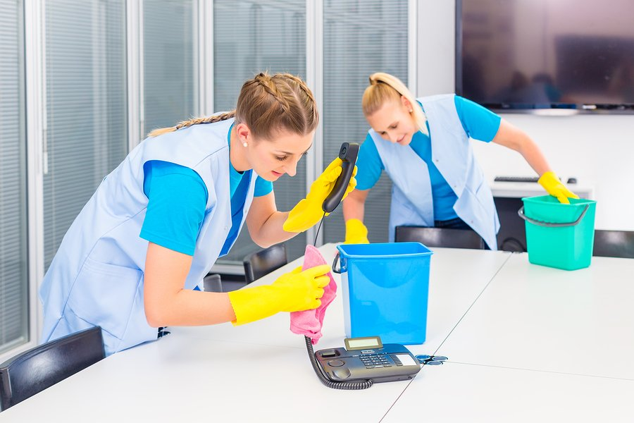 professional cleaners performing office cleaning duties