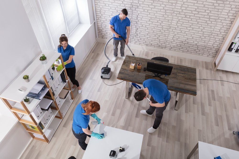 Commercial Cleaning Company Technicians in a modern office setting