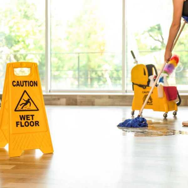commercial cleaner mopping office facility