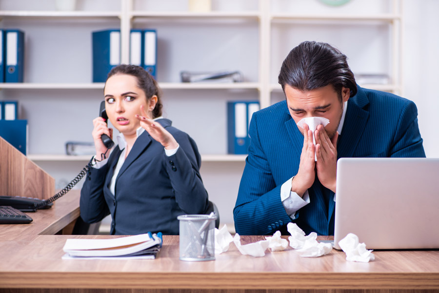 employees coughing proving a sanitize and disinfection company is needed