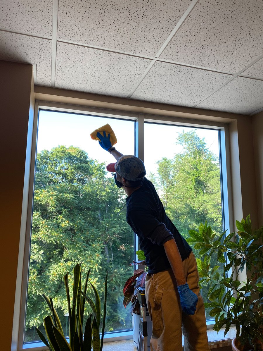cleaning technician professionally cleaning and office