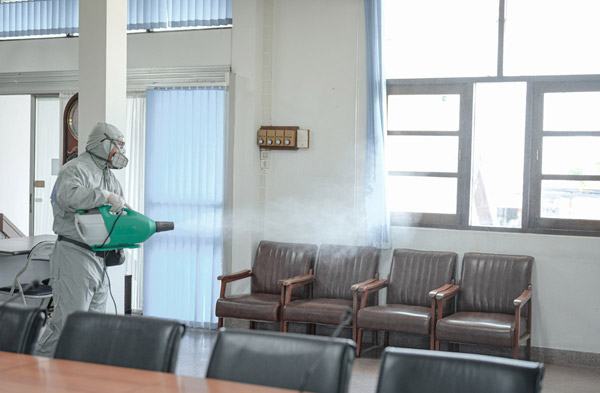 cleaning technician delivering electrostatic spray disinfection services